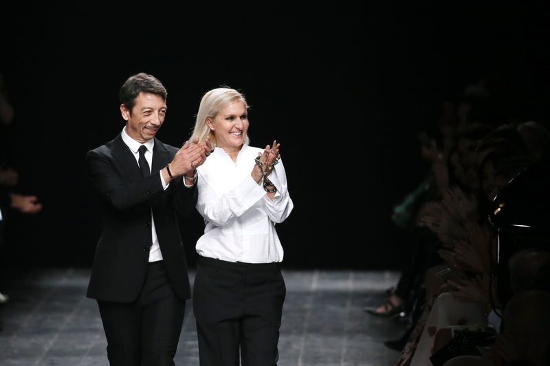 Italian designers Maria Grazia Chiuri and Pier Paolo Piccioli appear at the end of their Fall/Winter 2016/2017 women's ready-to-wear collection for fashion house Valentino in Paris, France, March 8, 2016. REUTERS/Gonzalo Fuentes