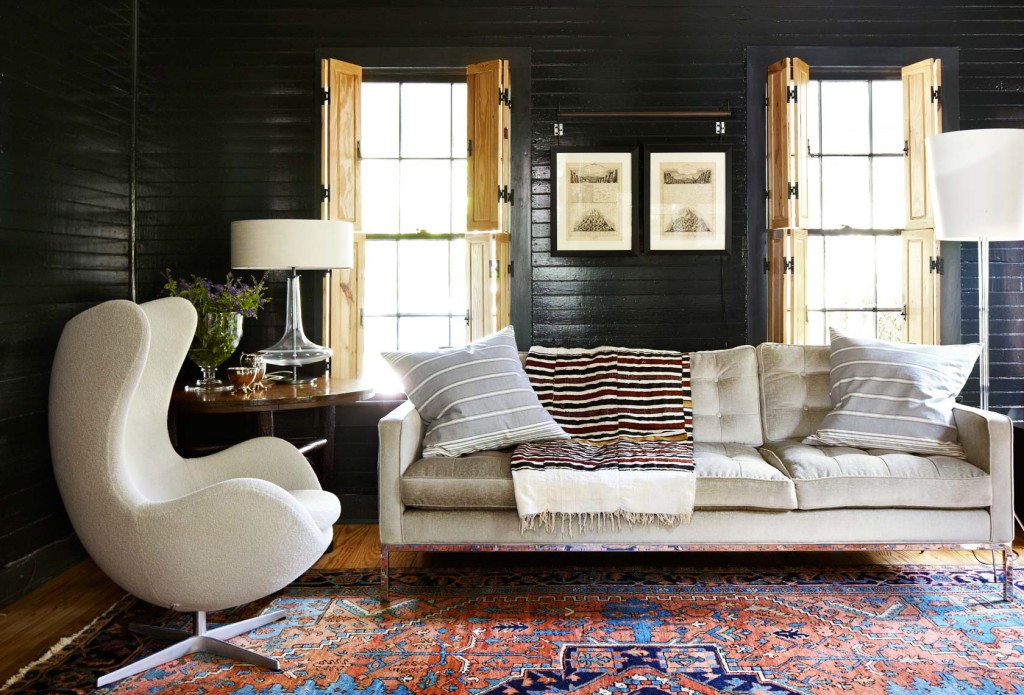 cool black painted living room at the country chic Cuppett House in Austin, Texas